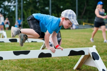Boy jumping over an obstacle