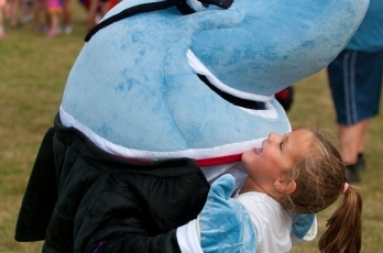 Sharkie the Mascott playing with a kid